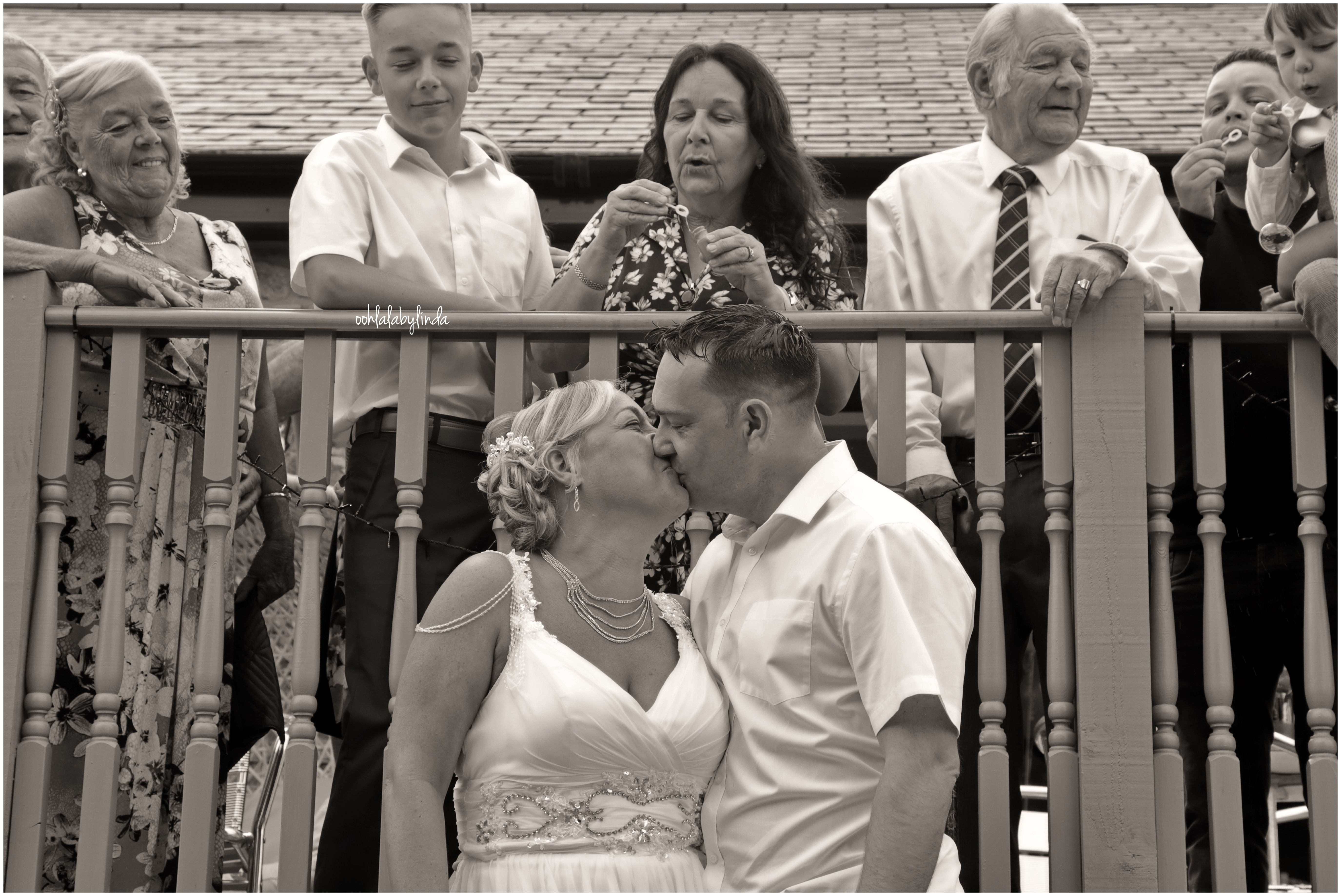 beide adn groom kissing black and white