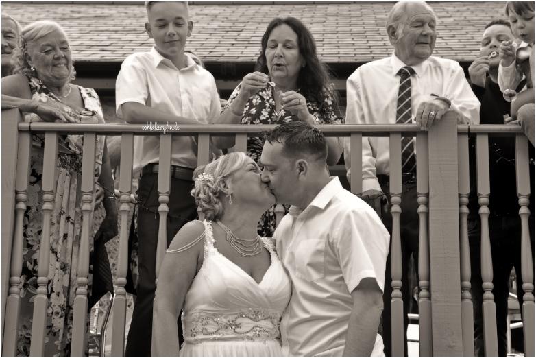 beide adn groom kissing black and white