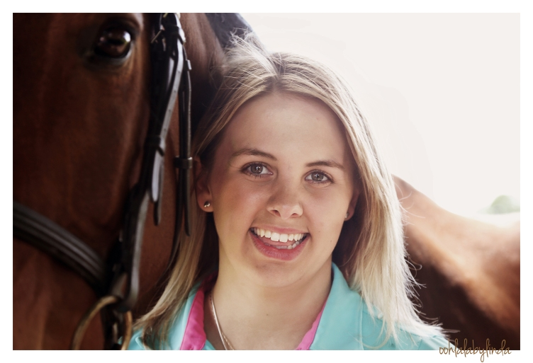 head and shoulders portrait of girl with her horse