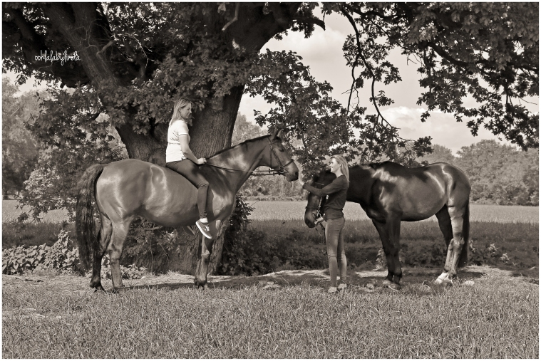 black and white portrait of girls with horses