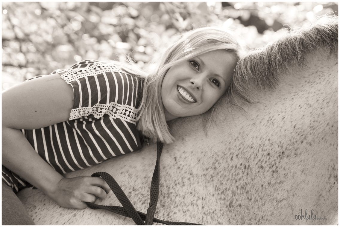 black and white portrait of young girl with her horse