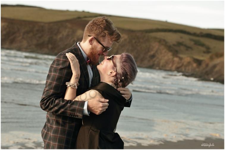 Bride and groom kiss on the beach