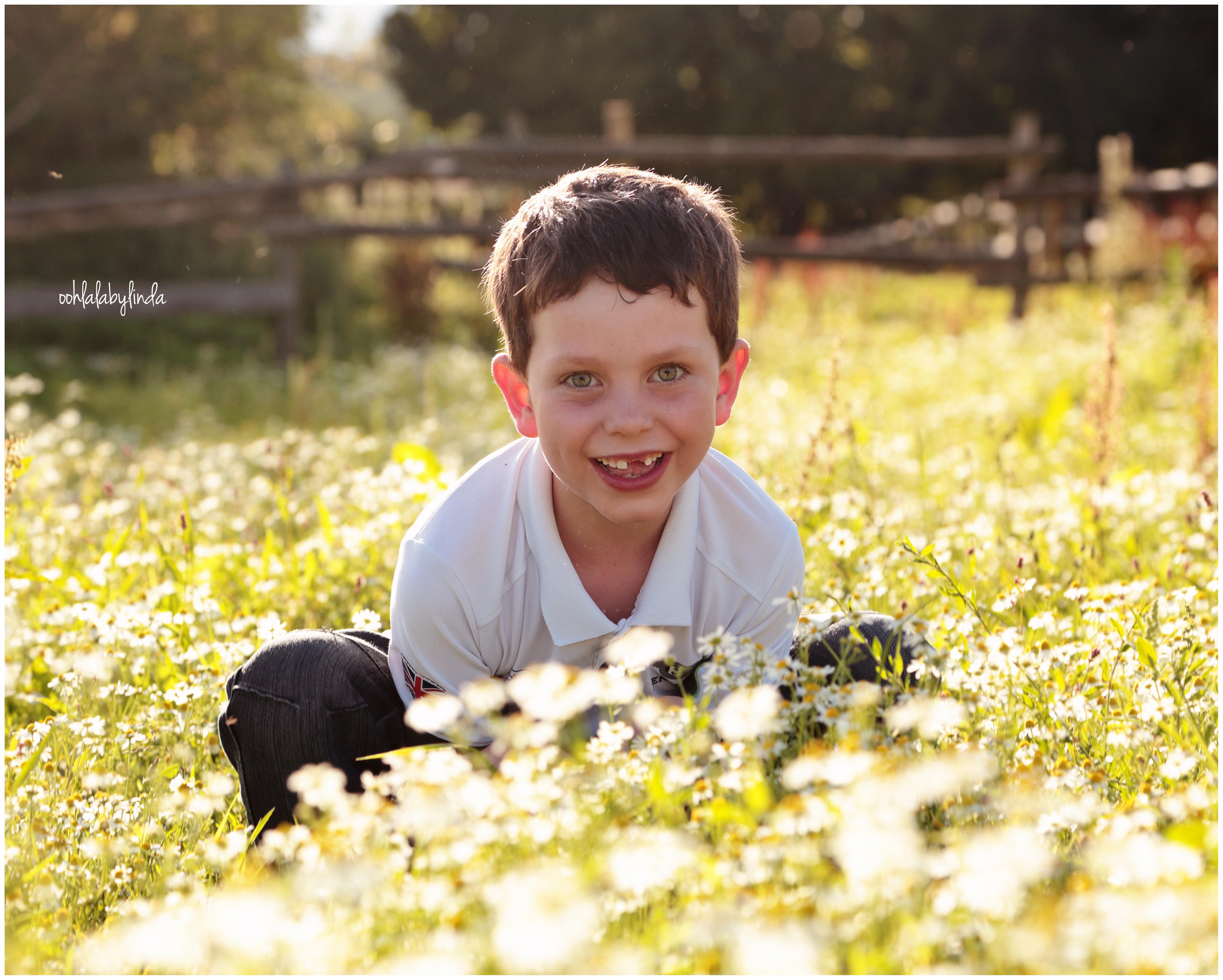 portrait of little boy in the field
