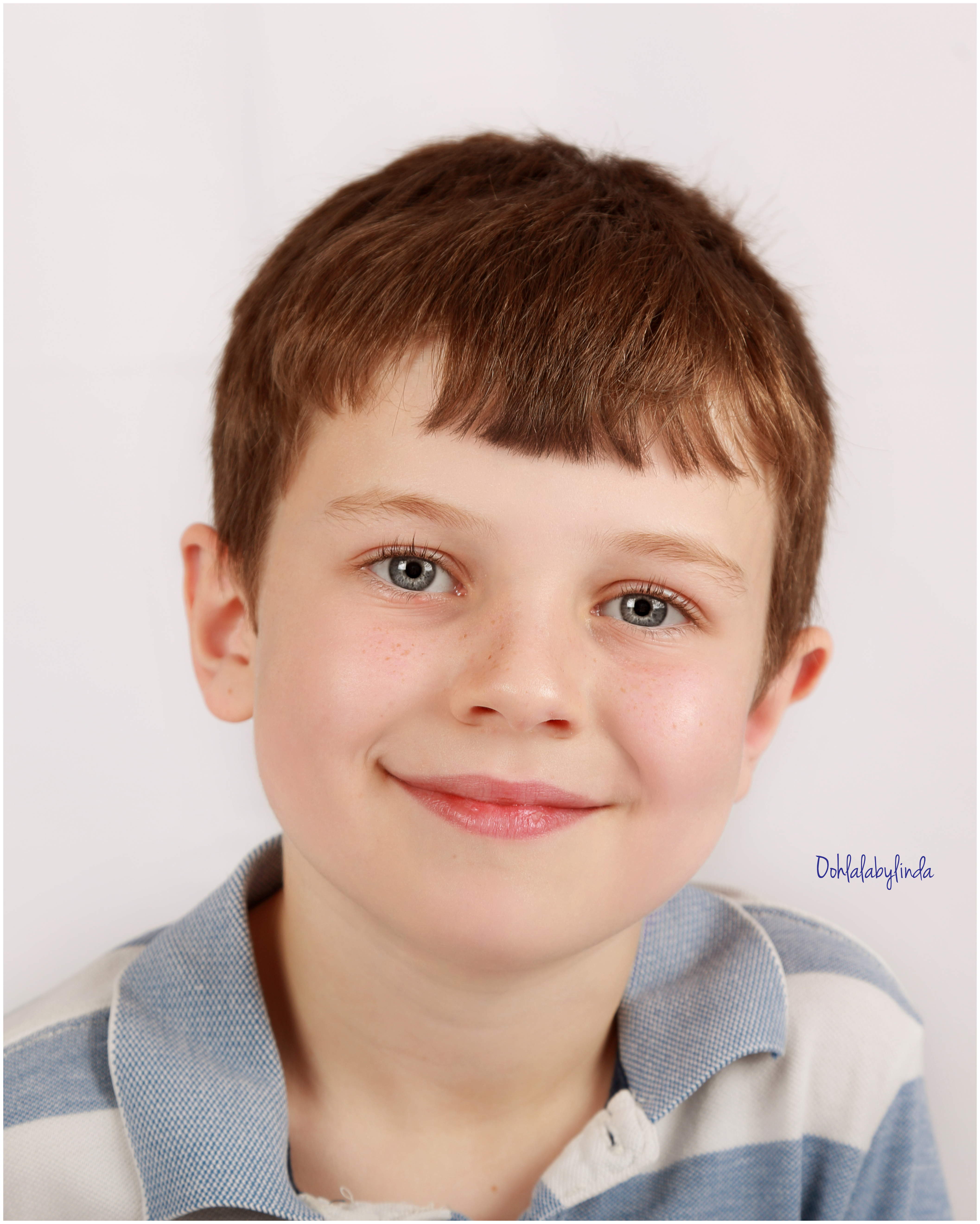 Head and shoulders portrait of little boy