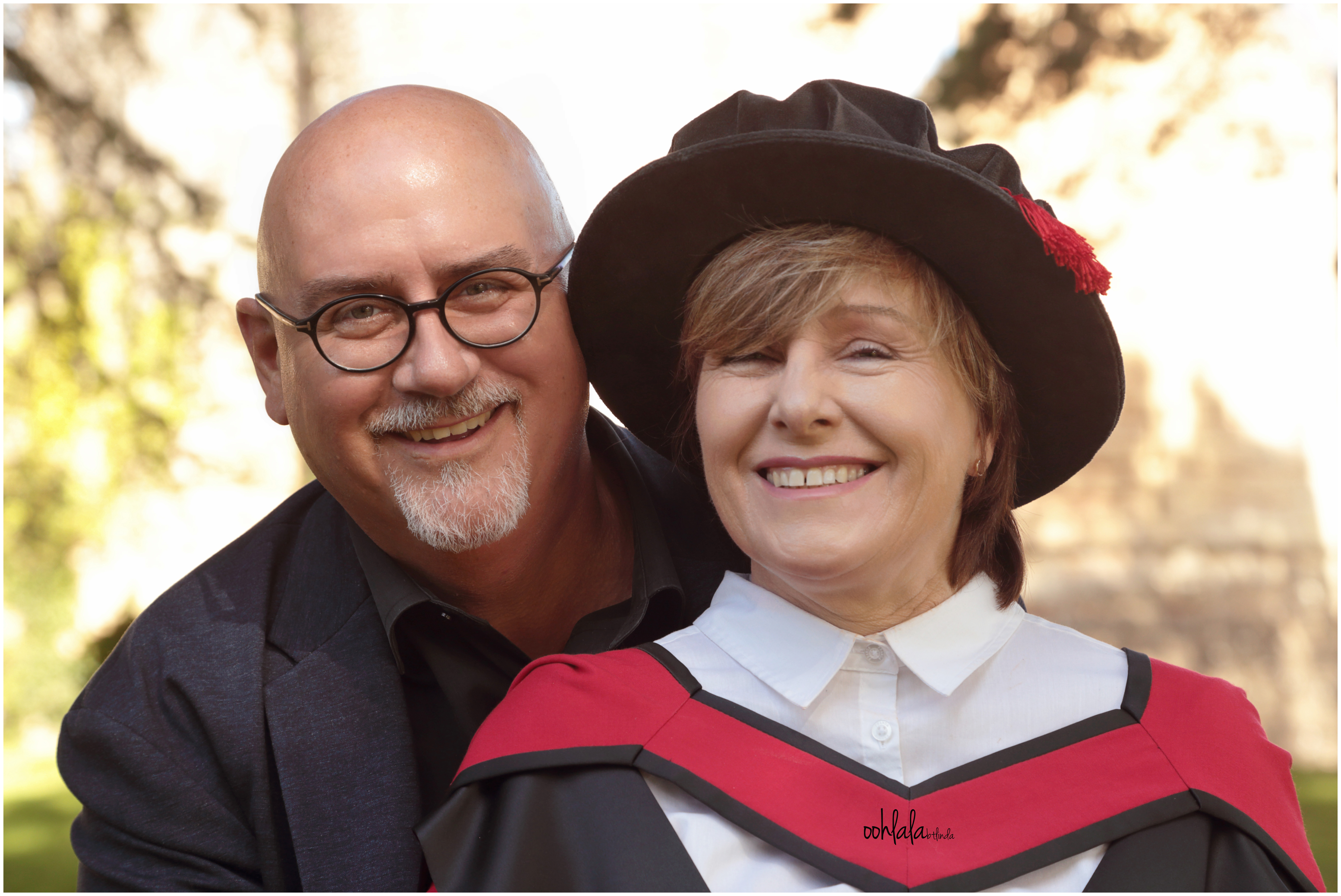 couple smiling for masters graduation shot